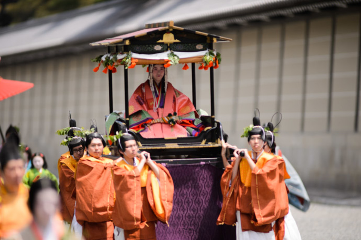 In the modern era, a different unmarried woman from Kyoto is picked each year to serve as Saio (high priestess of the Kamo Shrines), who is carried in the festival on a palanquin.