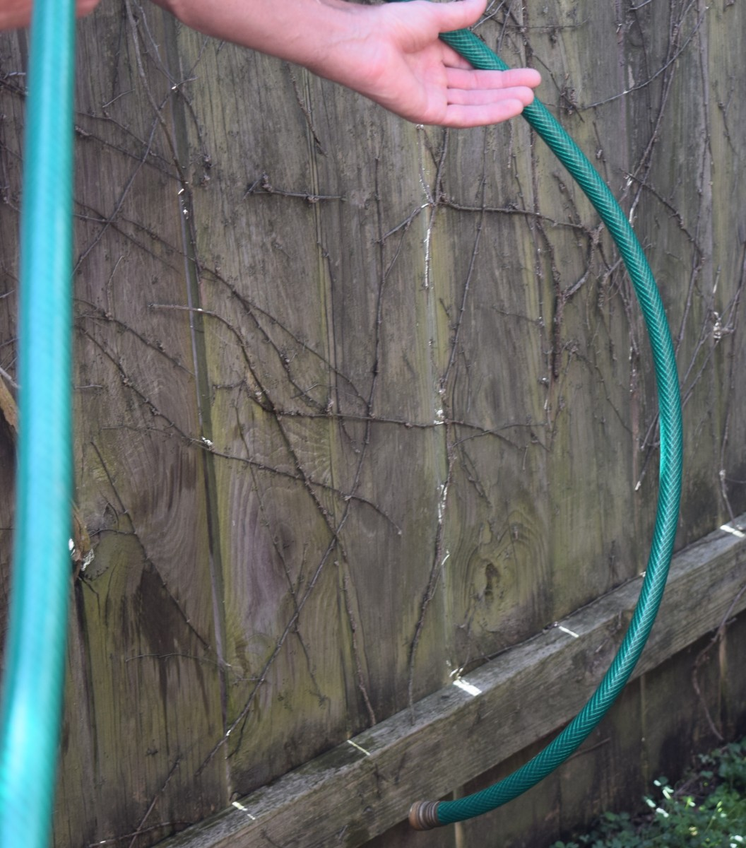 Create a water slide with the hose to empty it.