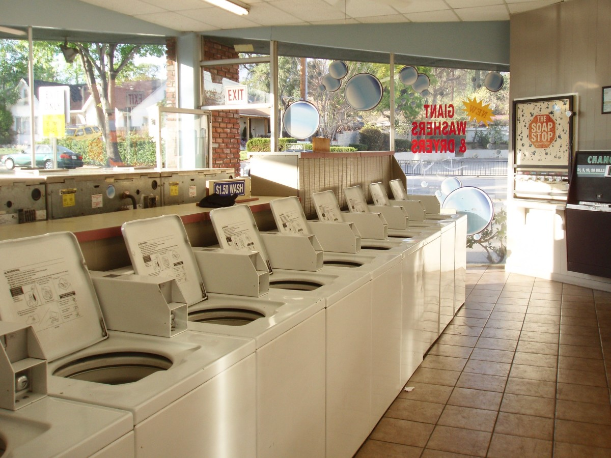 Laundromats can look modern or rundown, depending on how well they're maintained. This one is quite nice, with everything I like in a laundromat . . . except comfortable benches. But then I've never seen a laundromat with comfortable benches.