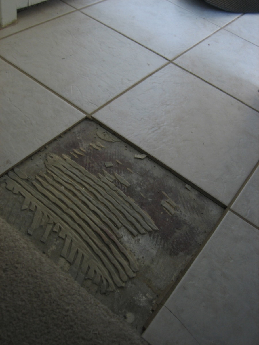Remove all old thinset mortar before setting a new tile.