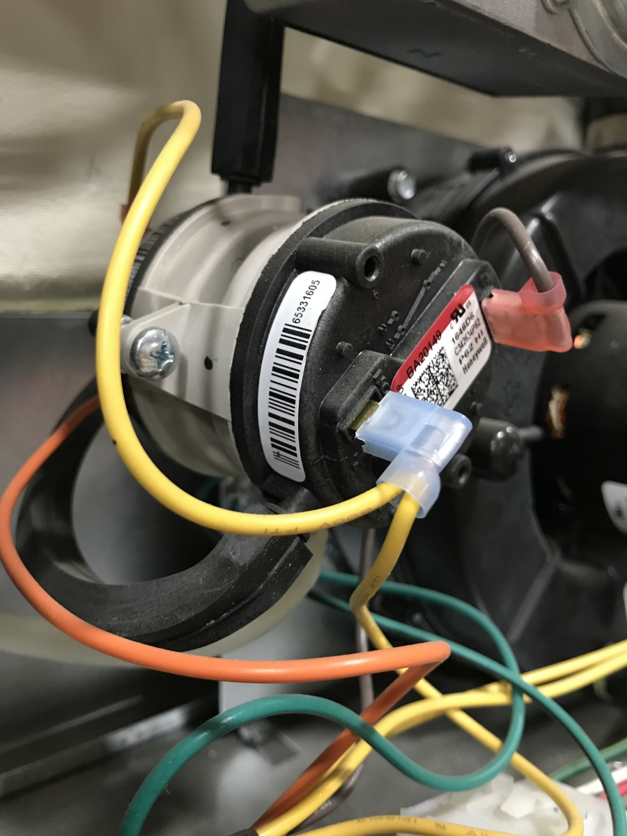 "This is what a ""pancake"" type pressure switch looks like and if you need to replace it you just replace them both since that is likely how you will have to buy it."