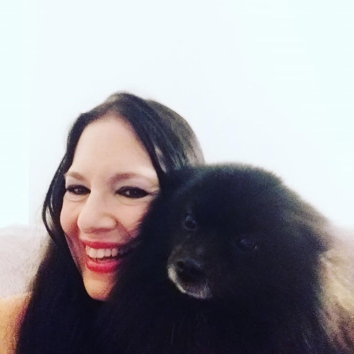 Author Andrea Picarelli of Orlando, Florida, with her beloved Pomeranian, Oliver.