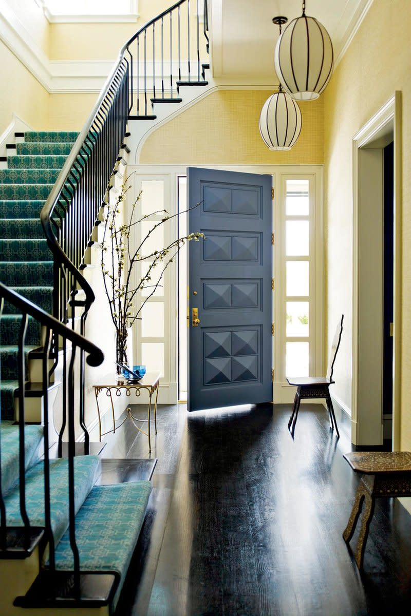 An entryway with high ceilings looks best with a soft pastel or neutral.