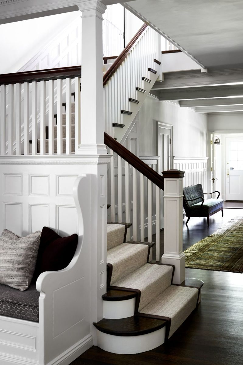 This renovation has plenty of architectural detail: wainscoting, built-in seating, traditional newel posts, railings and balustrades.