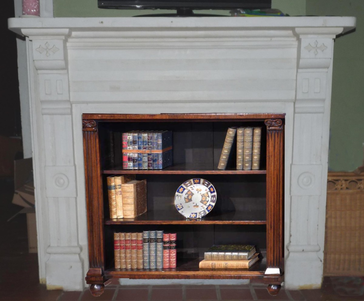 Small bookshelf in front of closed off fireplace
