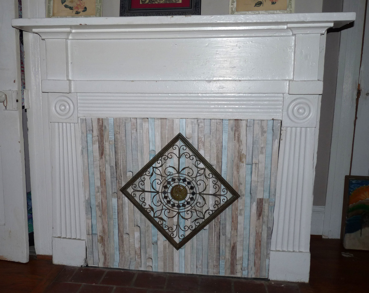 Pretty, beachy closed off fireplace