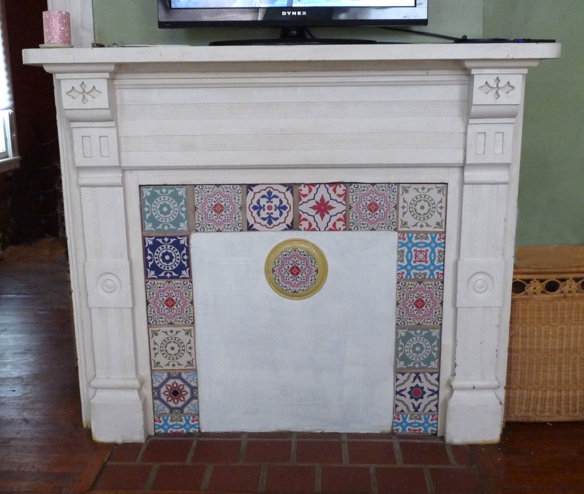 Closed off fireplace with decorative tile