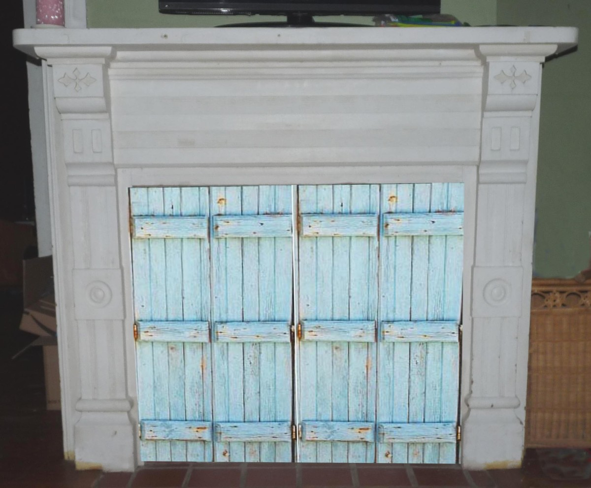 Blue shutters covering closed off fireplace