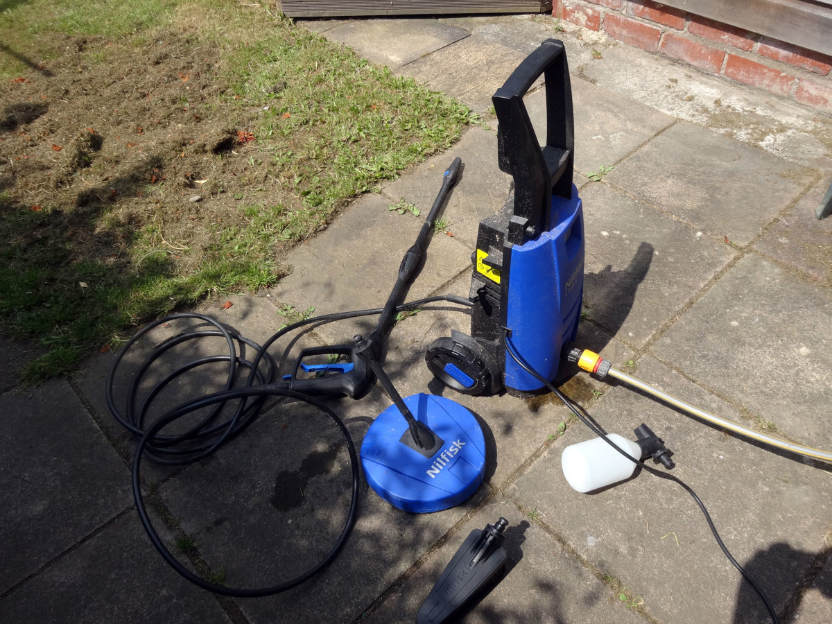 The big blue round object is the compact patio and decking cleaner. Also, the bottle attachment (which fits onto the handle and filled with cleaner) when used for car washing.