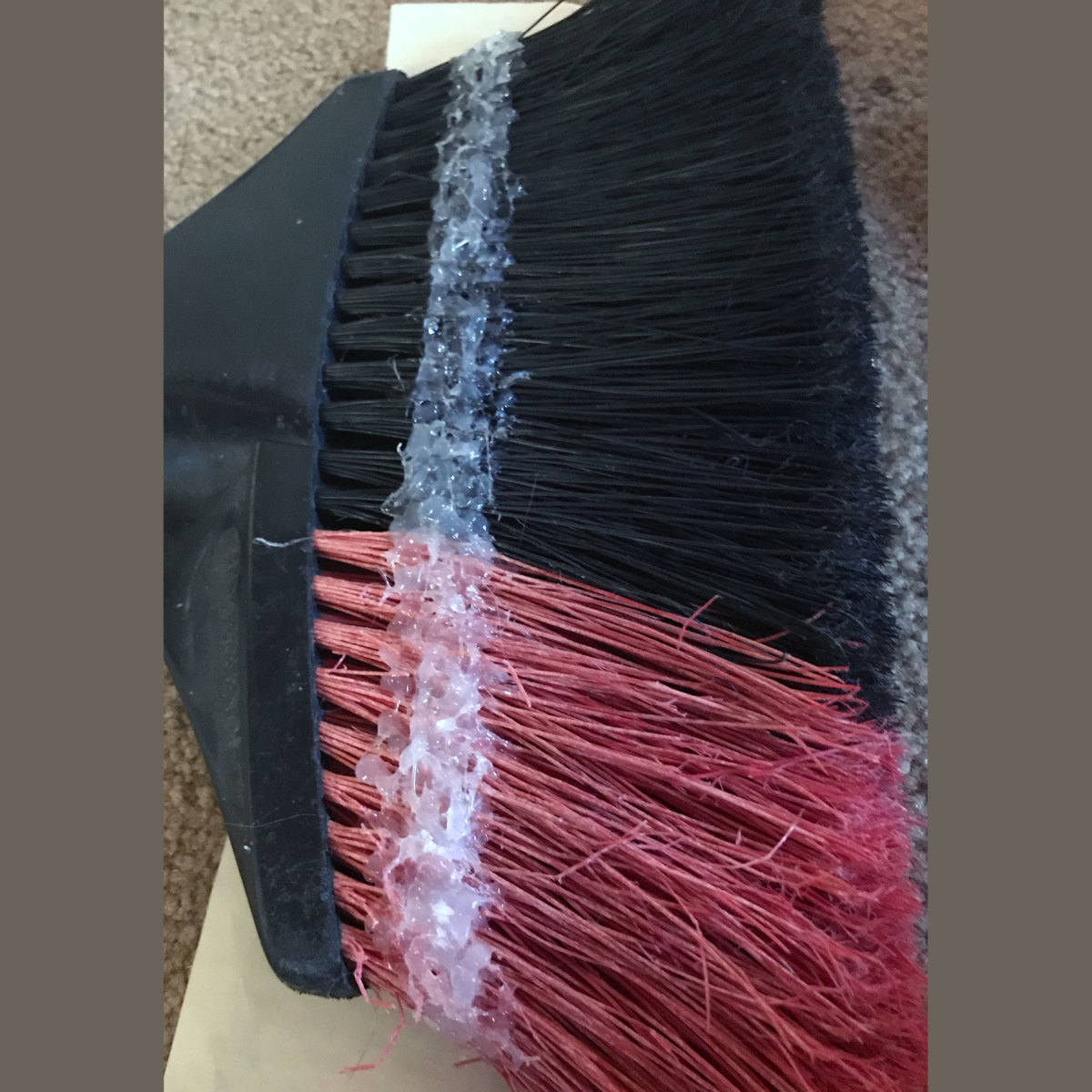 Hot glue penetrates to include all bristles.