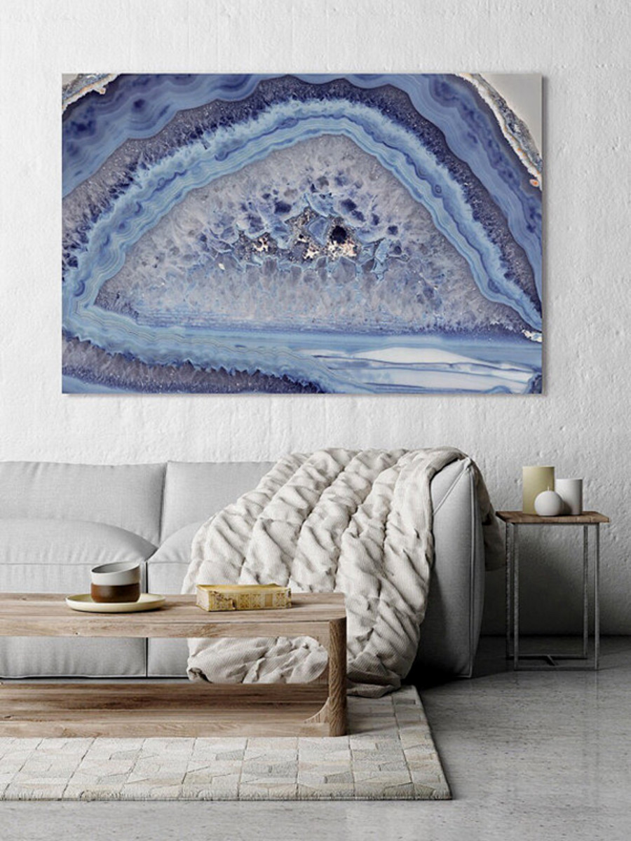Huge artwork on a wall expanse creates a big statement.
