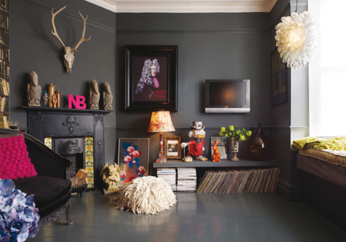 A bold-hued wall gives the room a dramatic feel.