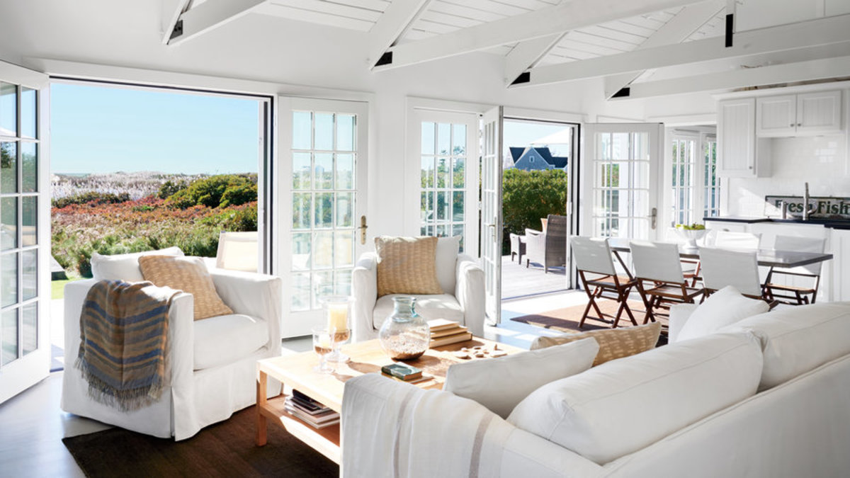 If you have plenty of windows move the seating to take in the summer breeze, flowers and the views.