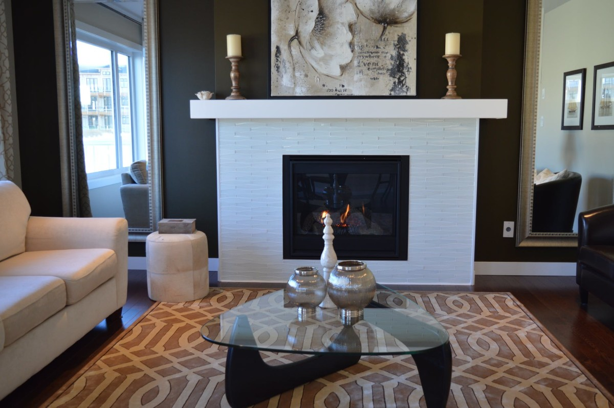 The focal point in this room is the fireplace and the mantel artwork.