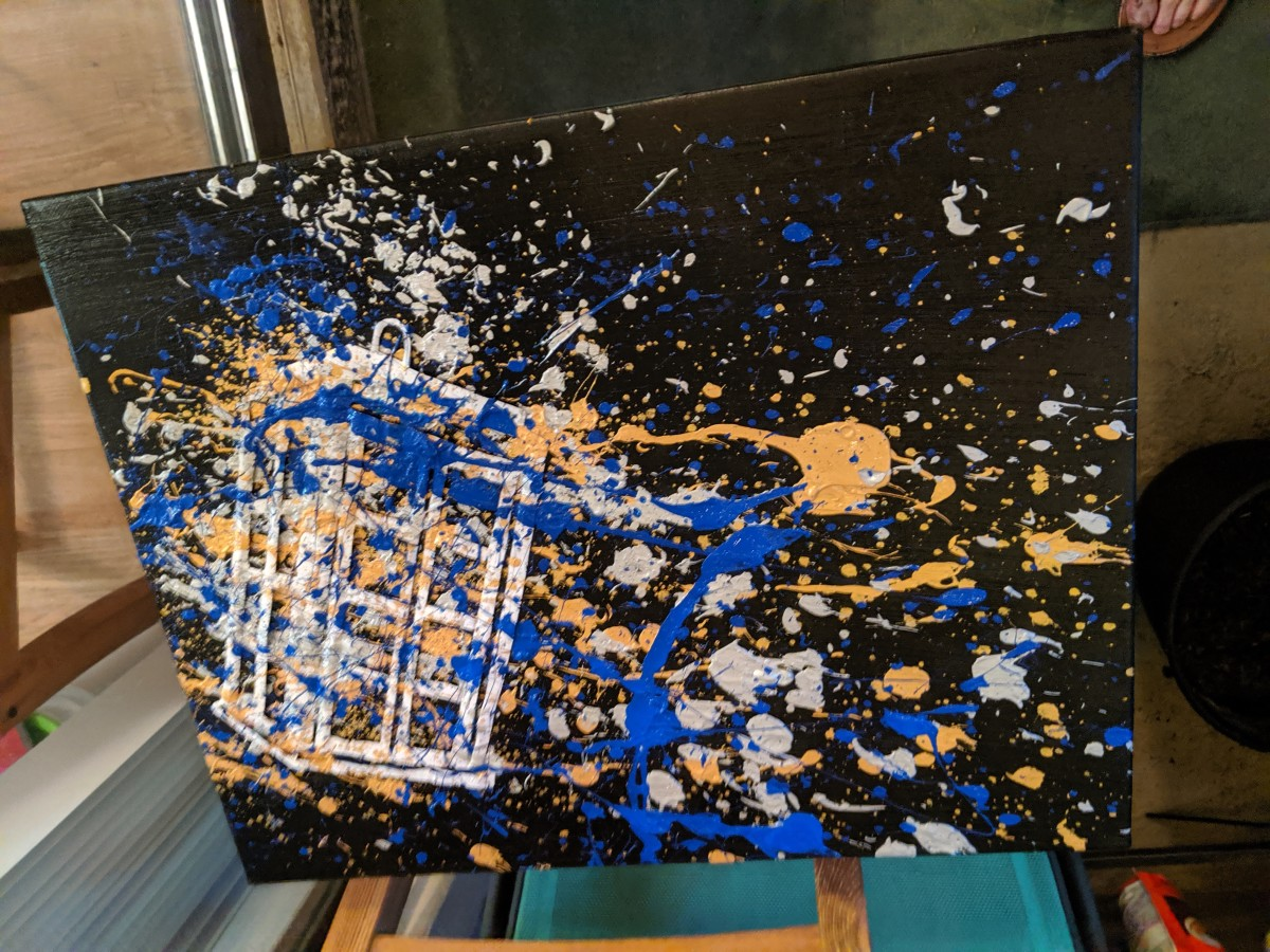 Letting the paint dry after splattering.
