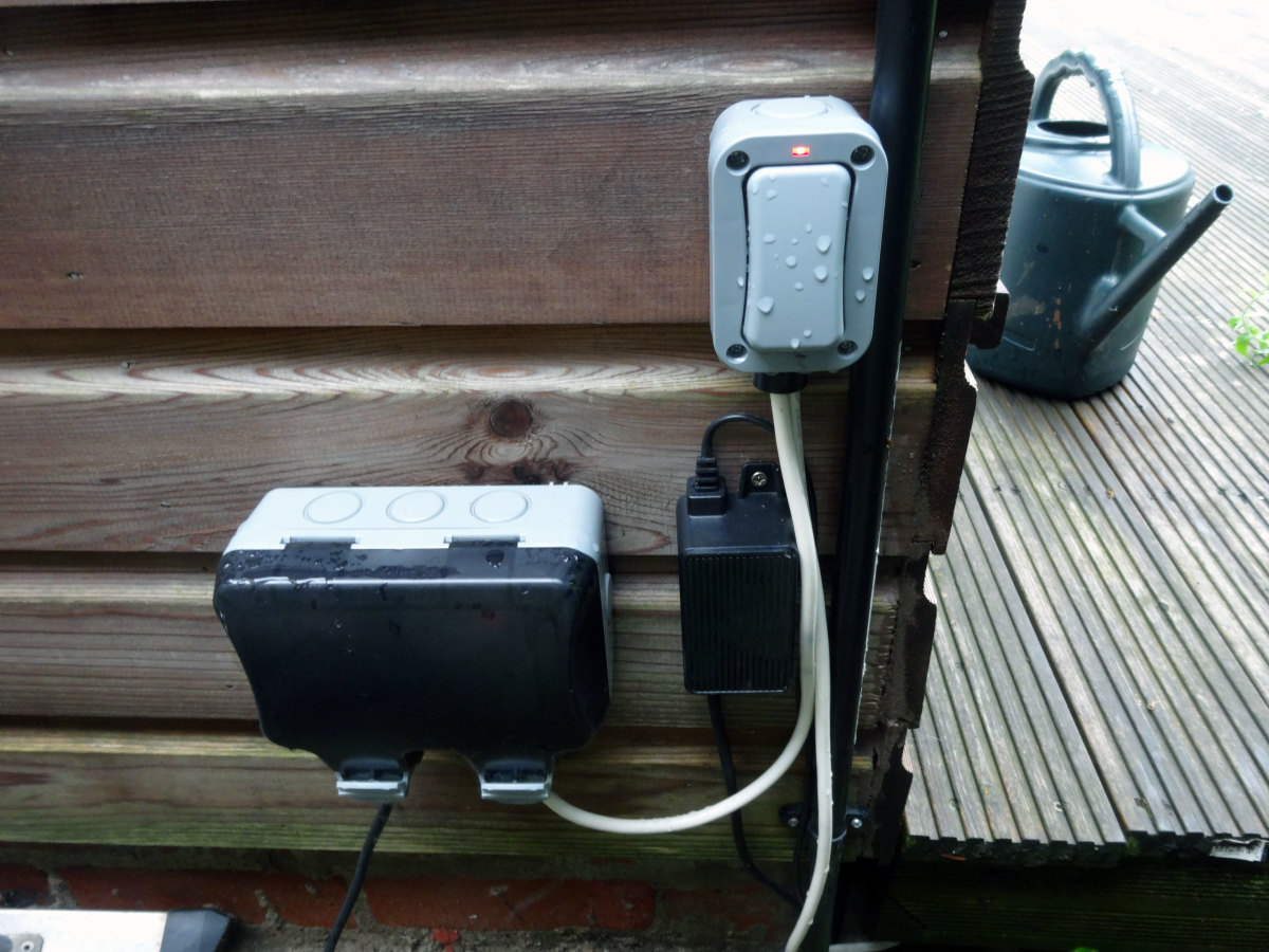 Double socket for robotic lawnmower and the exterior switch for the LED lights