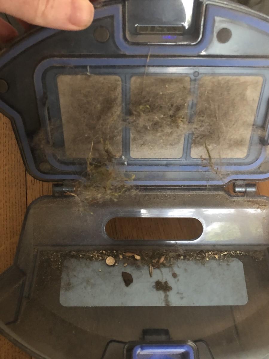 Eufy 11S dust compartment when open.