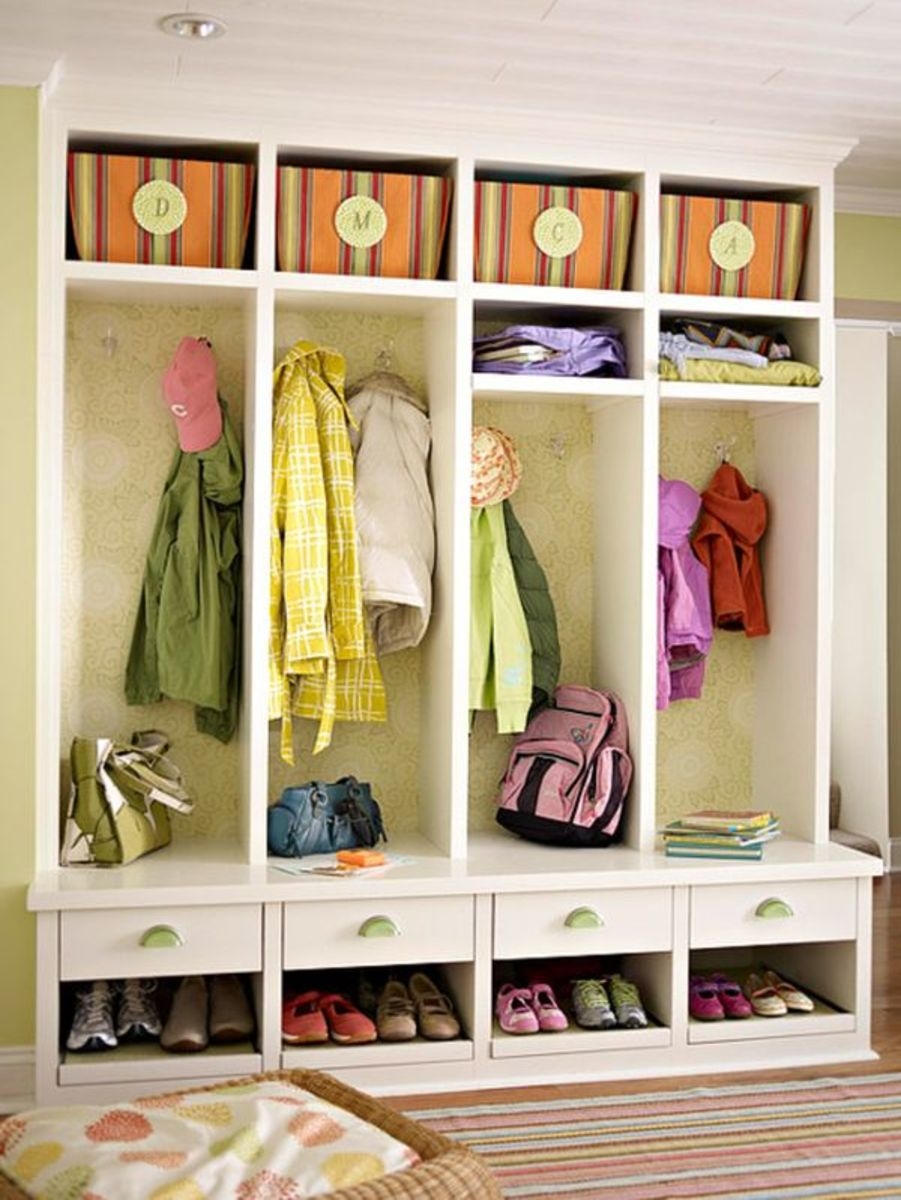 An entryway or mudroom with storage cubbies and hooks for coats and items is  ideal practical  organization.