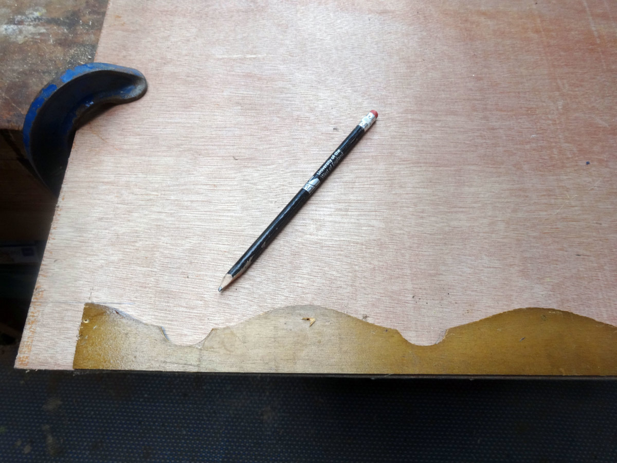 Marking the outline of the original decorative trim with a pencil, to give a guide for making the new trim.