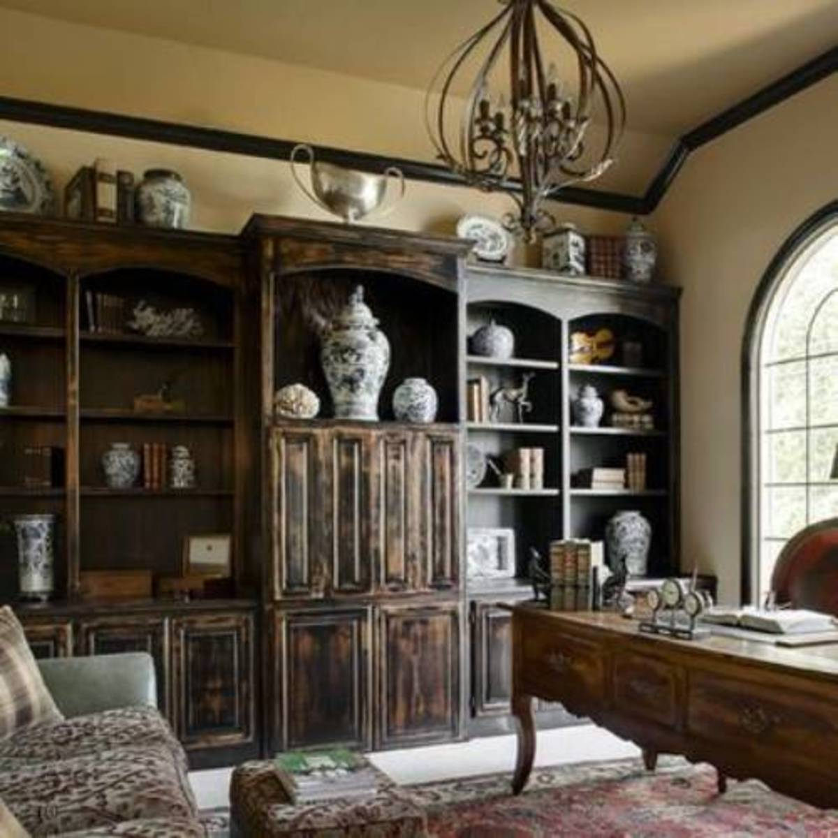 Beautiful accessories and lighting in a Tuscan home library.
