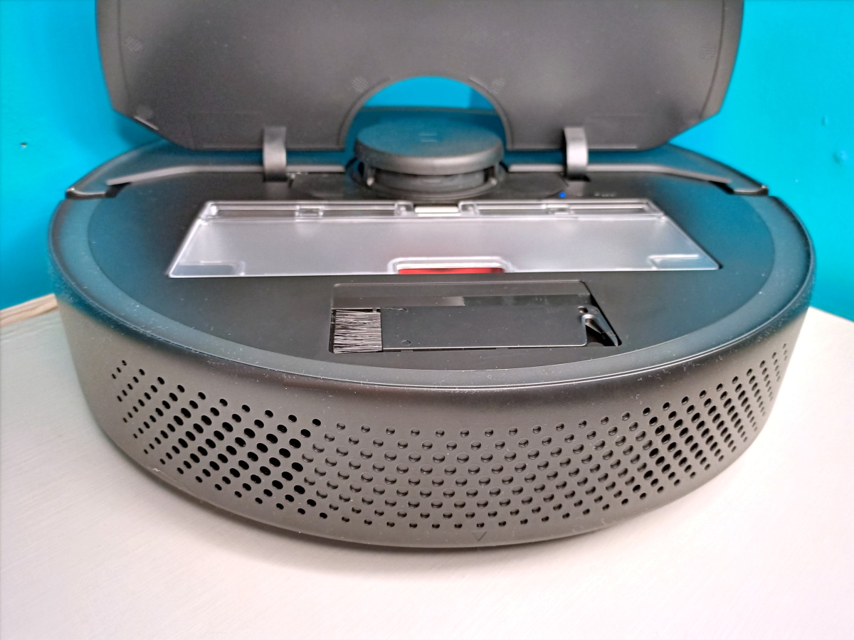 Roborock displaying dustbin and cleaning brush