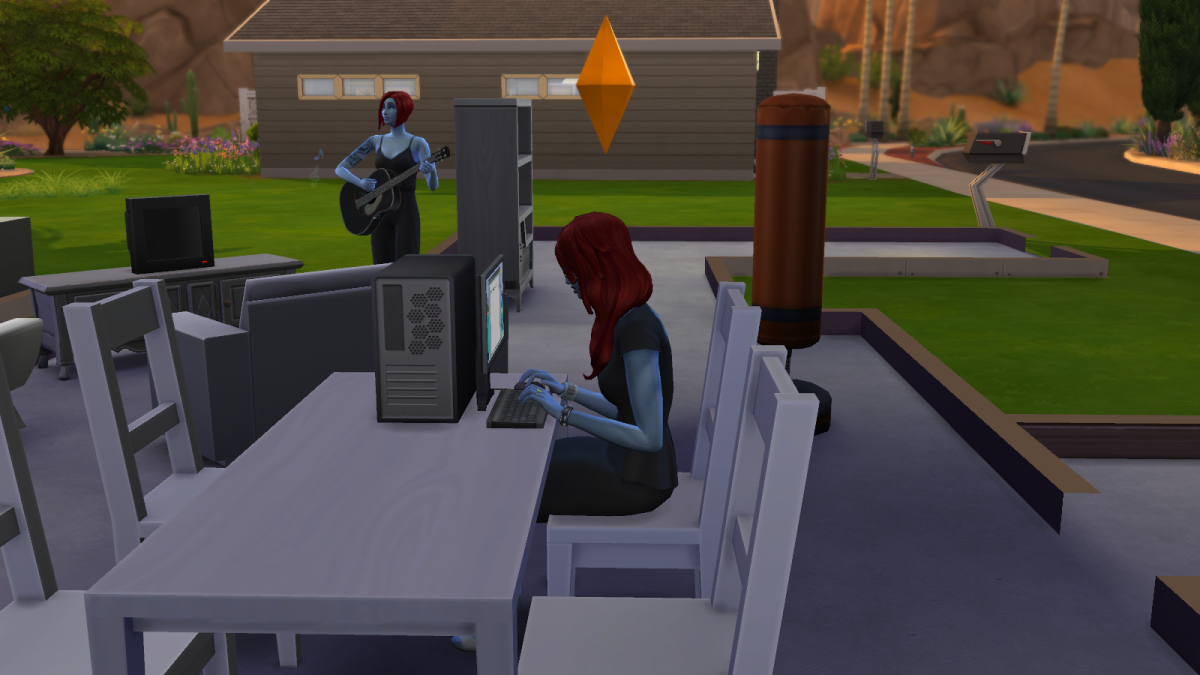 "Another sim at a computer in ""The Sims 4."" What can I say, all they ever do is sit at computers."