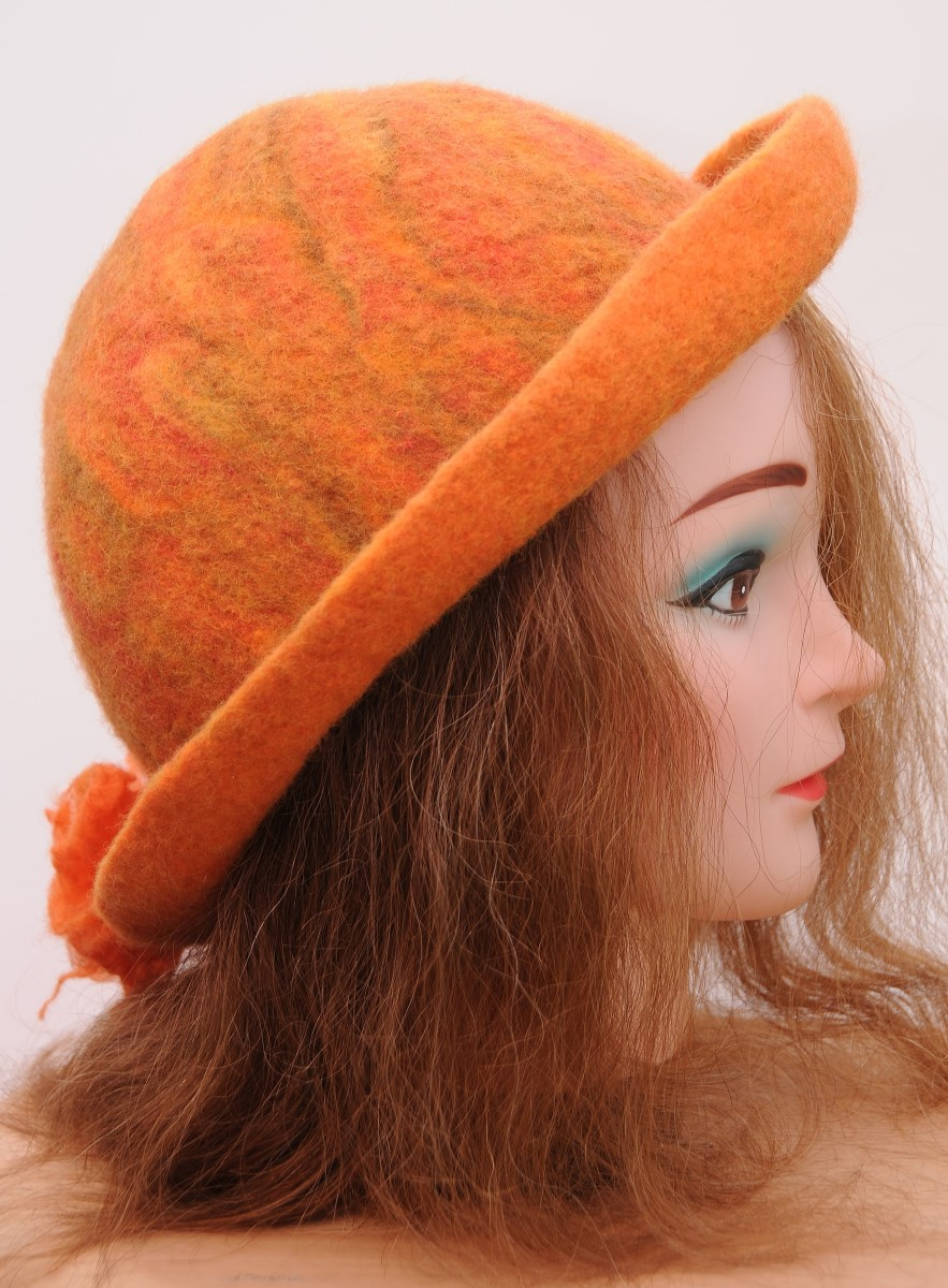 Wet-felted hat made using a resist template, complete with matching flowers.