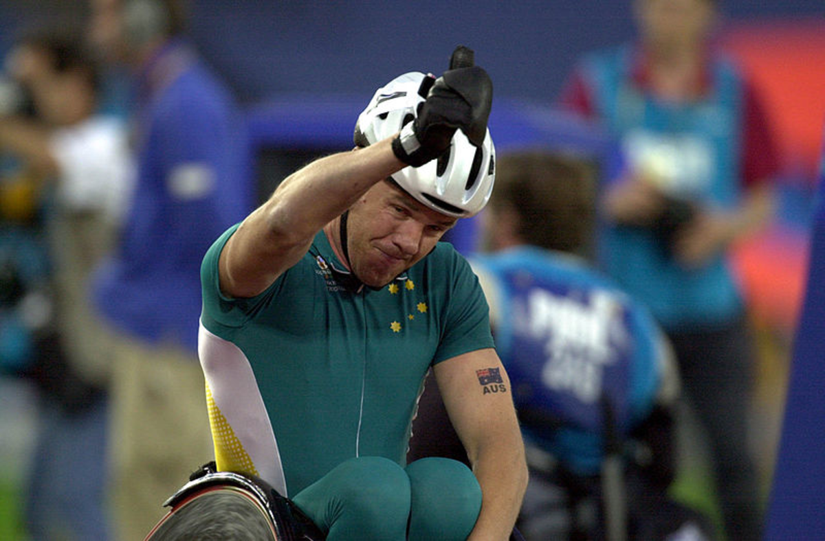 Wheelchair athlete giving thumbs up