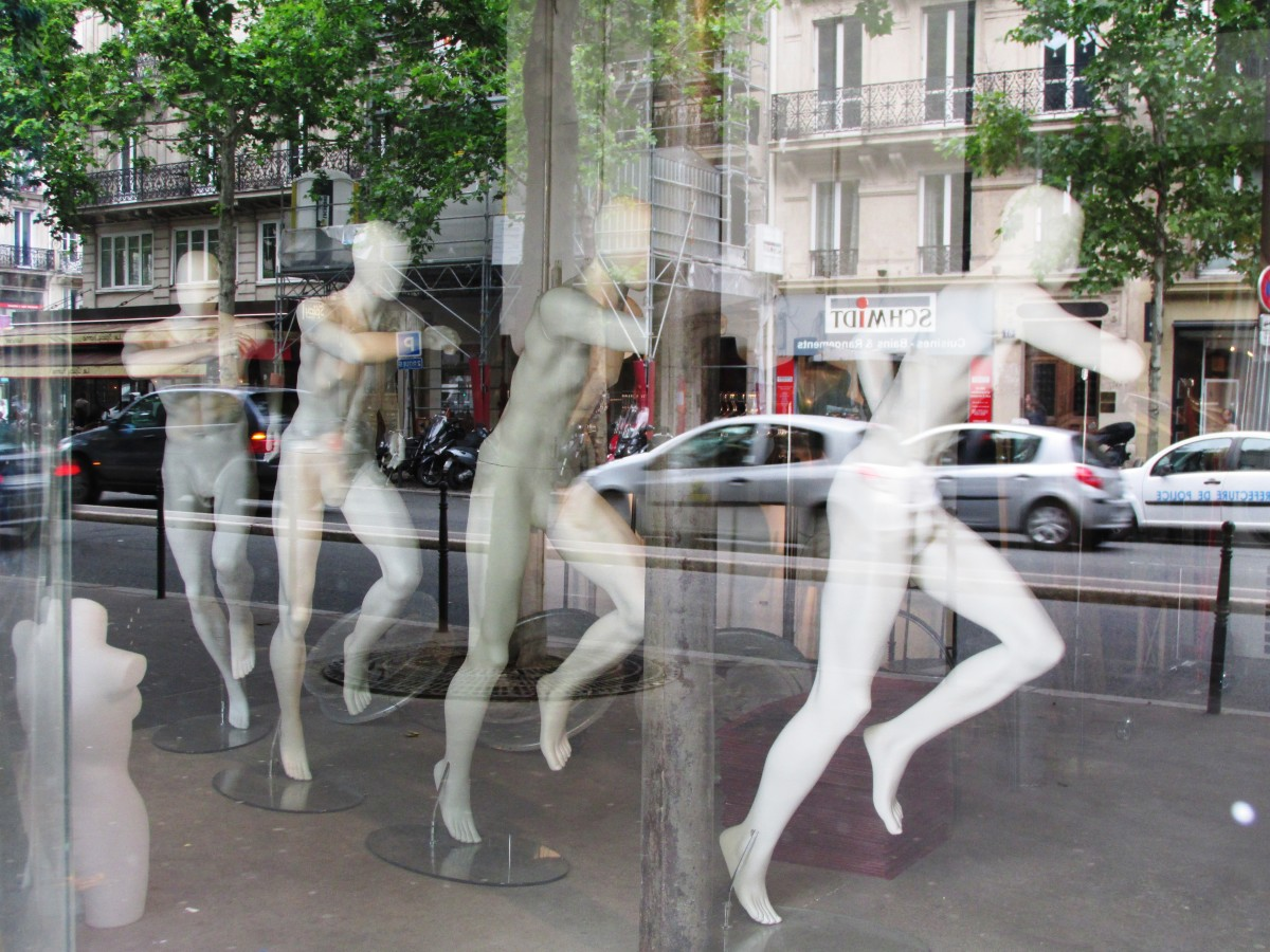 Did I catch them in the middle of naked mannequin aerobics?  Is there a message to these mannequin displays?  Or, does the window designer just have an offbeat sense of humor?