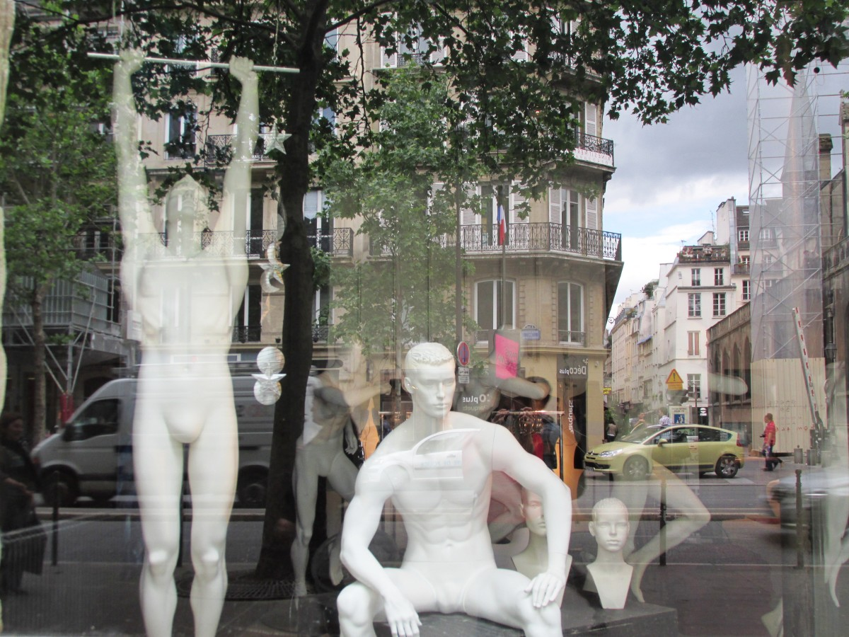 Who is being watched -- people on the street or these mannequins?