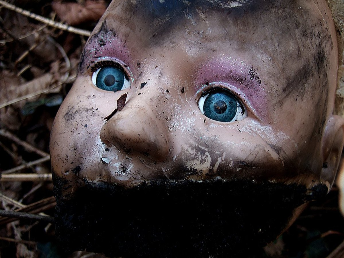 "Some little girl once loved this doll.  Now she is discarded and forgotten.  She looks surprised to be covered in filth.  ""I used to be somebody."""