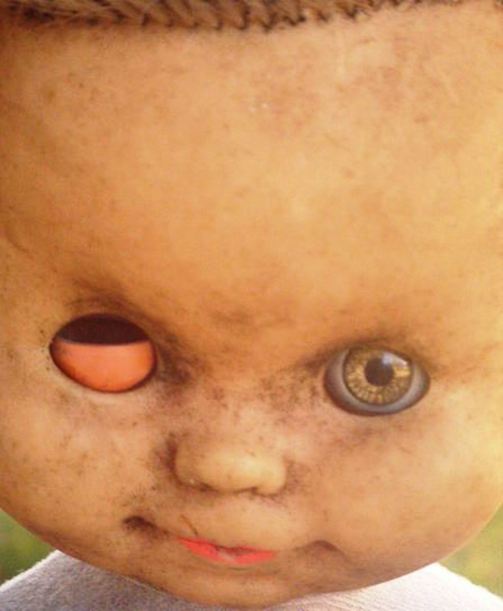 This dirty dolly needs a good scrub and an urgent trip to the doll doctor.