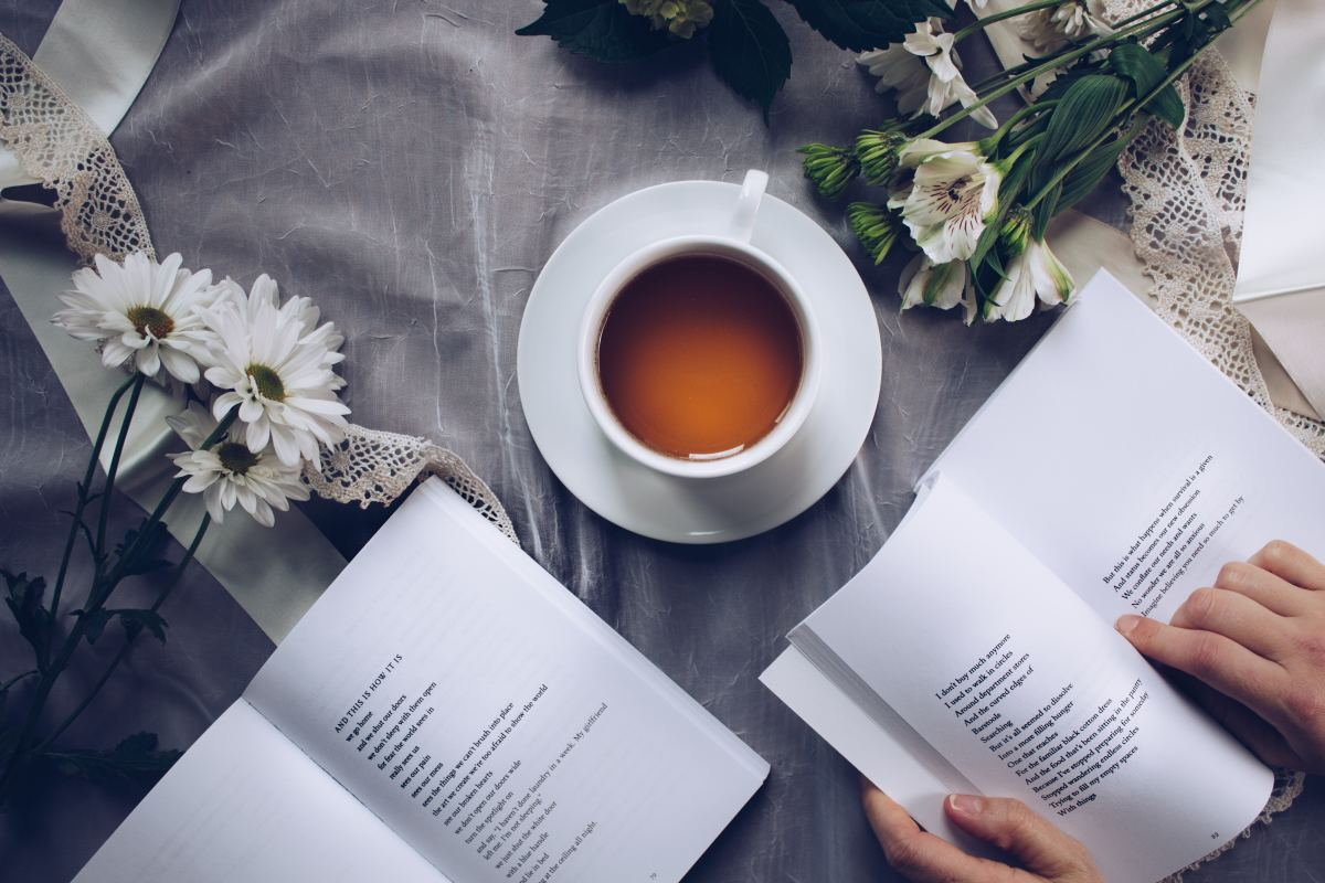 Person reading with a cup of tea