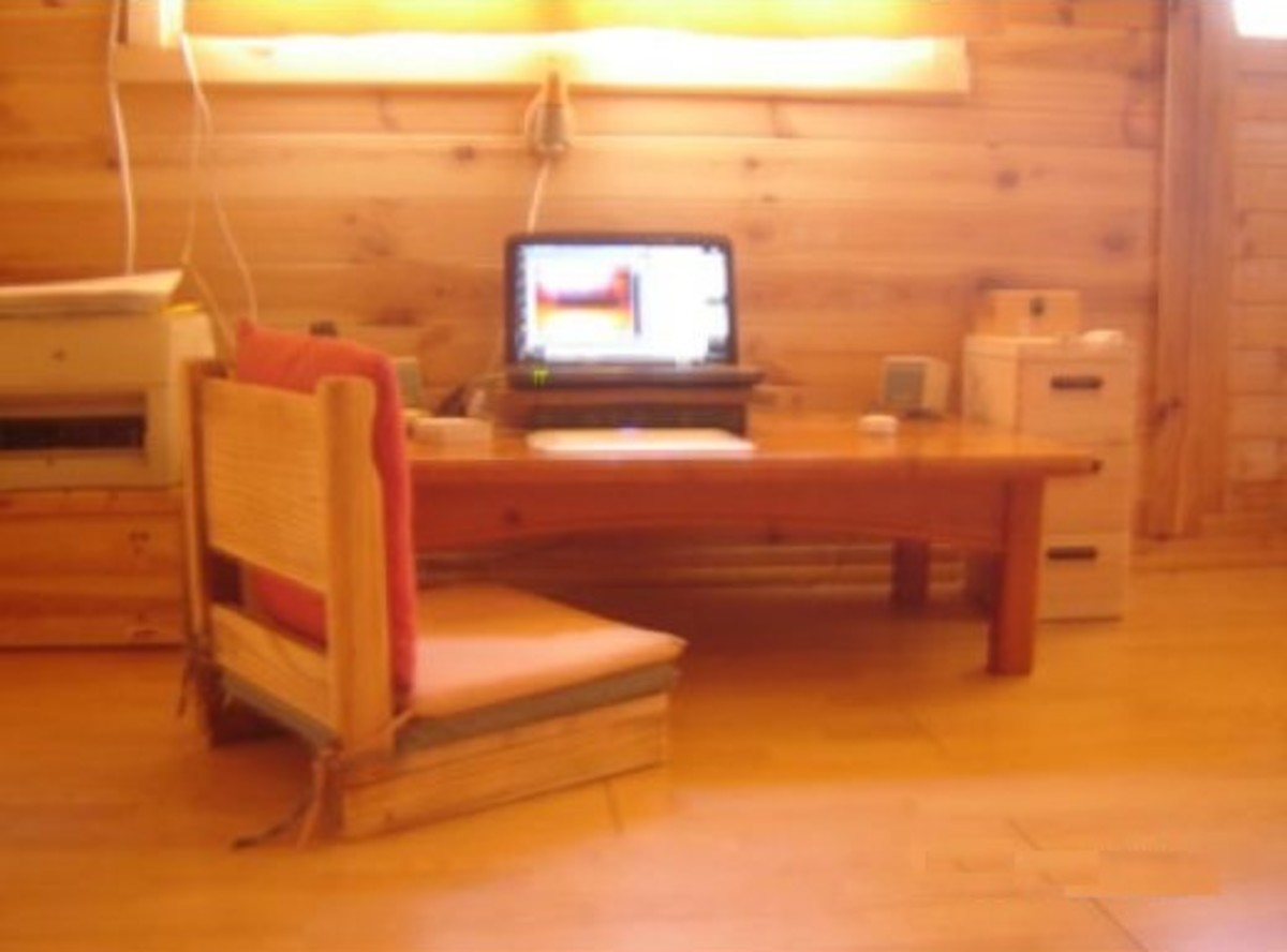 Low desk with legless chair.