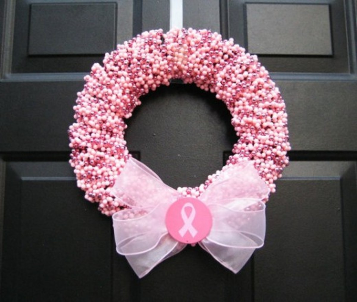 A pink wreath that can be sold in a silent auction or craft fair