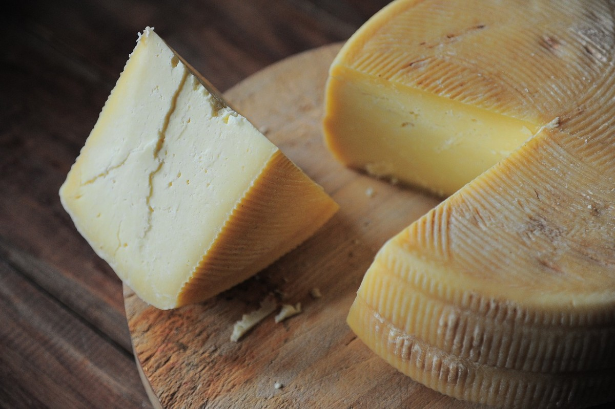 Hard cheeses have less lactose in them, so they might be okay for you to eat.
