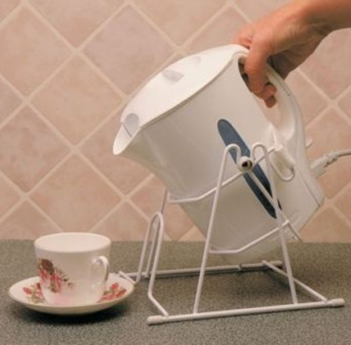 the kettle tipper makes pouring drinks a breeze