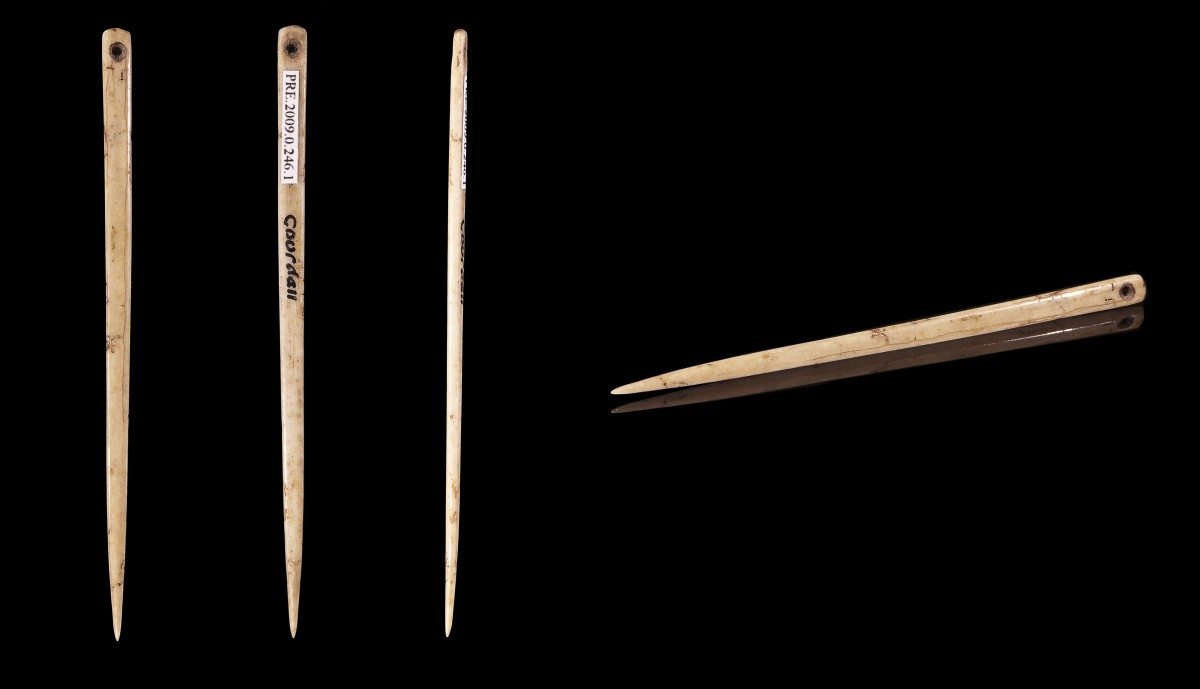 A flat bone sewing needle from the Upper Paleolithic period