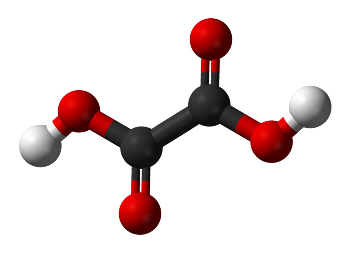 A model of an oxalic acid molecule: the black balls represent carbon atoms, the red ones represent oxygen atoms, and the white ones represent hydrogen atoms