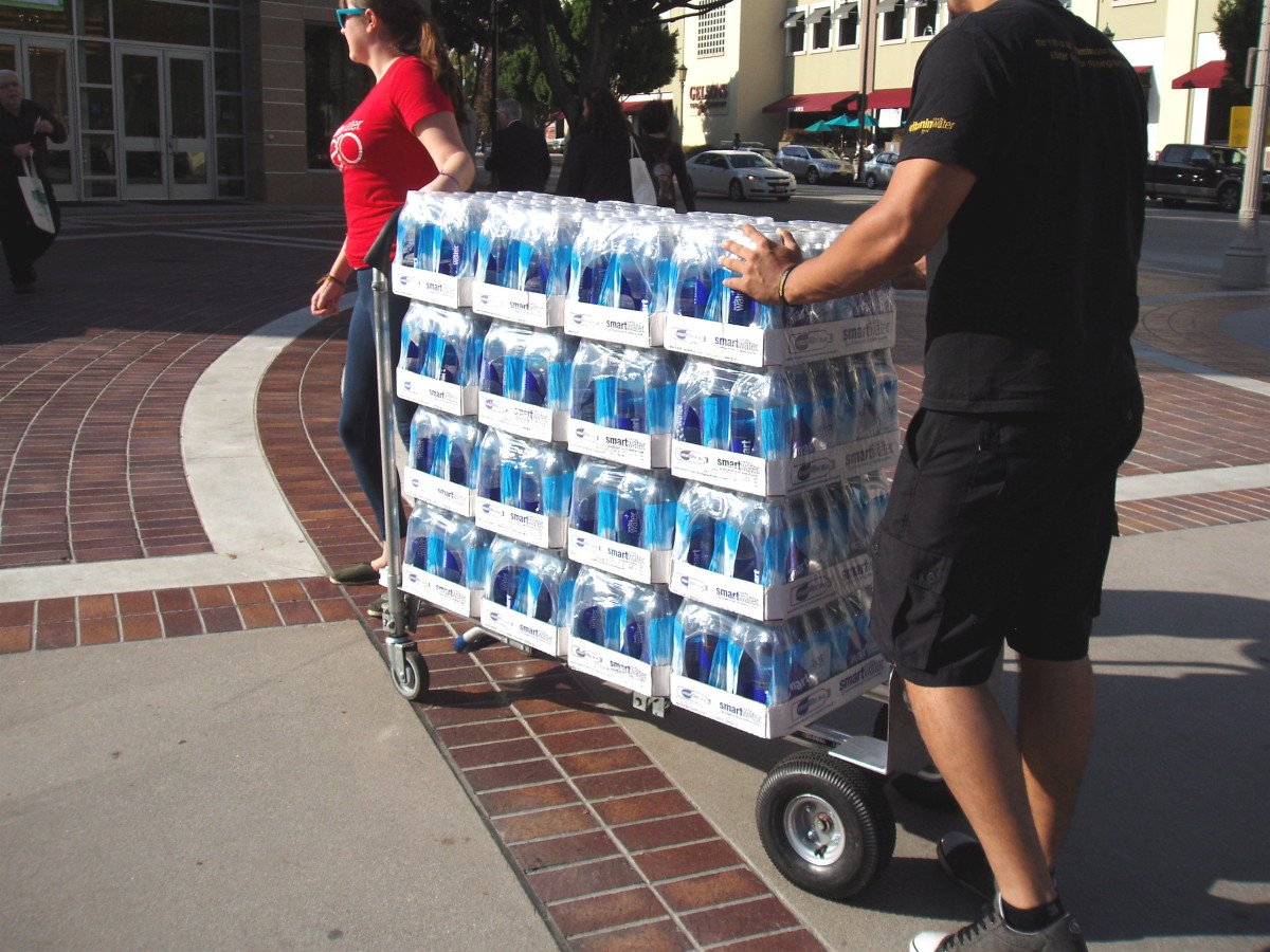 There's greater danger from bottled water leachates when the bottles are old or have been sitting in the hot sun for awhile. Cases like this are usually transported quickly from a refrigerated truck to shelves in the store to prevent that problem.