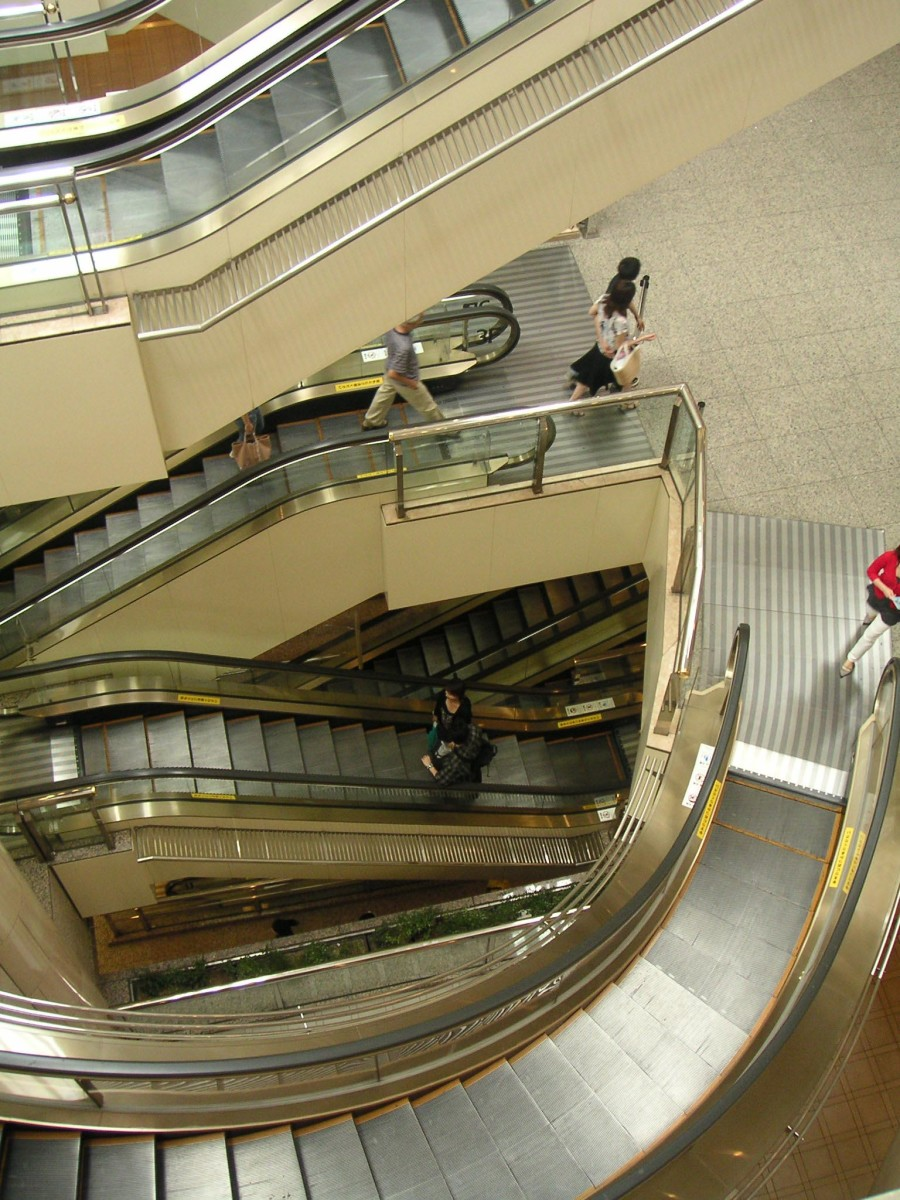 Escalator handrails have bacteria on their surfaces.