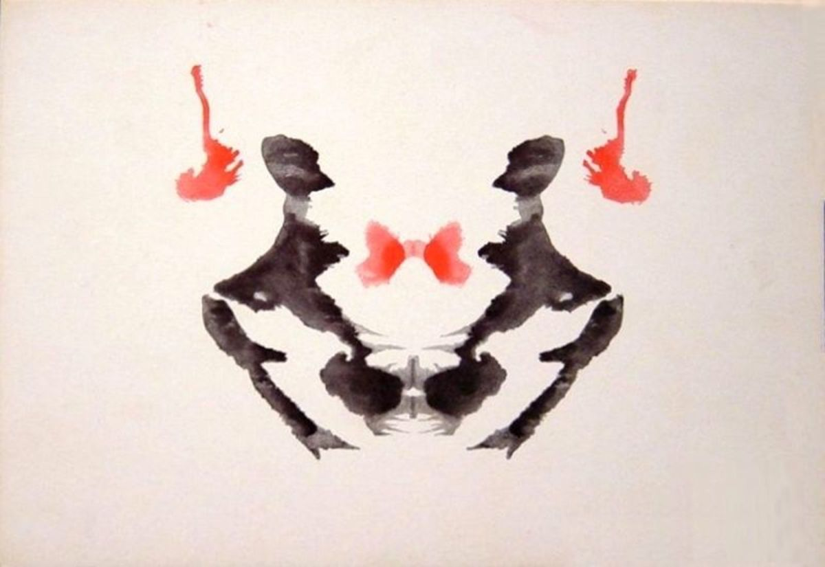 One card from the Rorschach inkblot test. What do you see here?