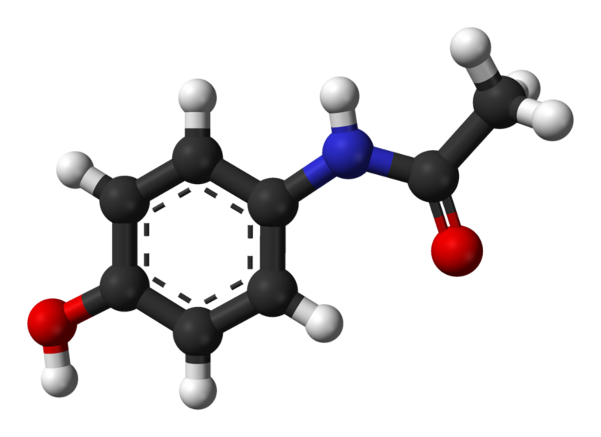 This is a ball-and-stick model of an acetaminophen or paracetamol molecule. Black balls = carbon atoms, grey balls = hydrogen atoms, blue ball - nitrogen atom, red balls = oxygen atoms.
