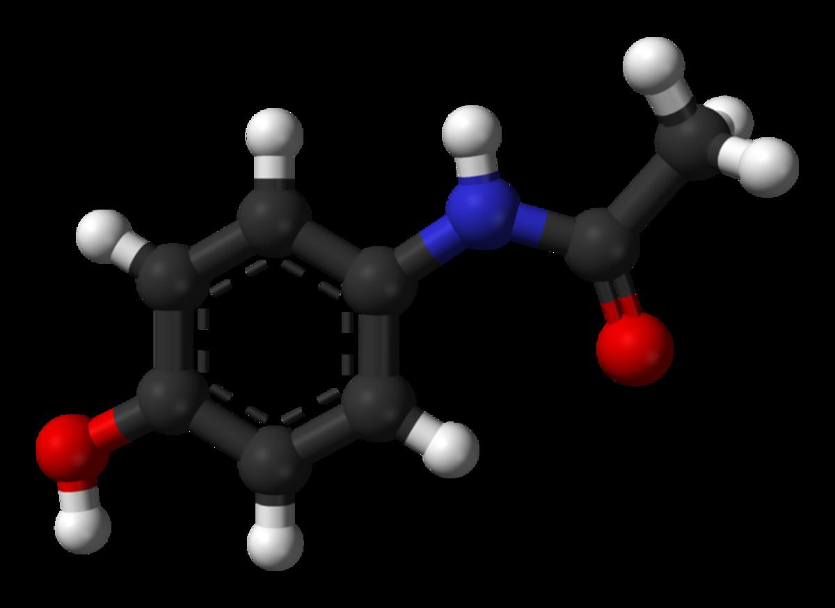 This is a ball-and-stick model of an acetaminophen molecule. Black balls = carbon atoms, grey balls = hydrogen atoms, blue ball - nitrogen atom, red balls = oxygen atoms.