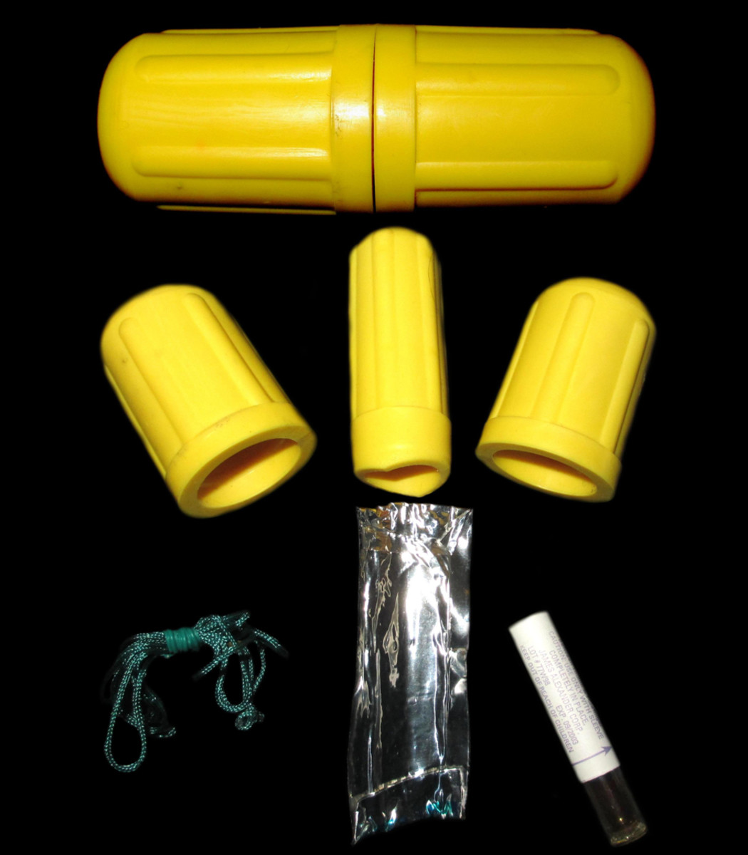 "An example of a commercially available kit to treat snakebite. This one consists of three suction devices (""suck""), rope to tie a tourniquet, a scalpel (""drain""), and iodine.  NEVER purchase or use these kits, as they always do more harm than good."