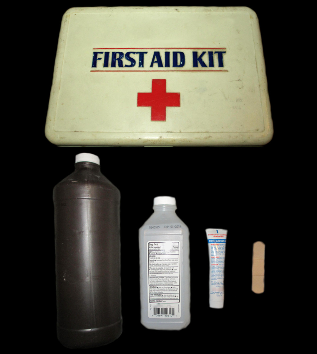 An example of some effective first aid techniques for snakebite: hydrogen peroxide and isopropyl alcohol to cleanse the bite site, antibiotic ointment to smear on the wound, and a bandage to cover/protect the puncture marks.