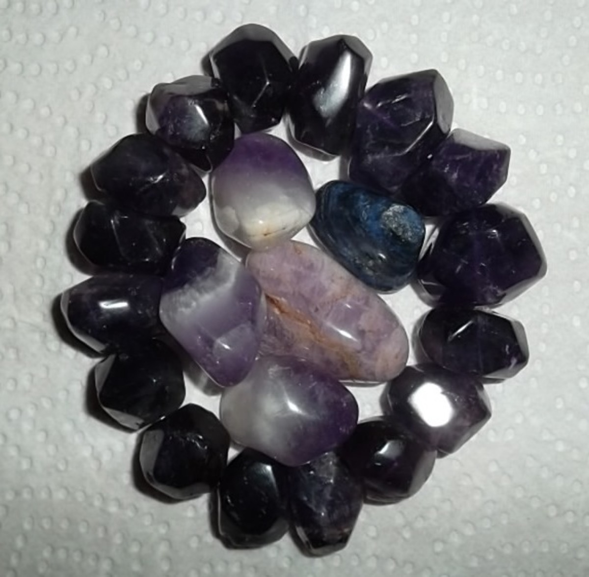 Amethyst is a violet variety of quartz. The ancient Greeks believed that wearing it protected one from becoming intoxicated