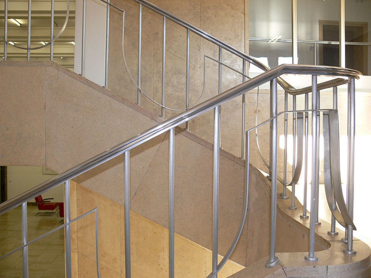 A staircase with metal handrails