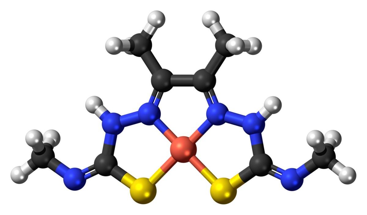 A model of Cu-ATSM; white = hydrogen, black = carbon, blue = nitrogen, yellow = sulphur, orange = copper