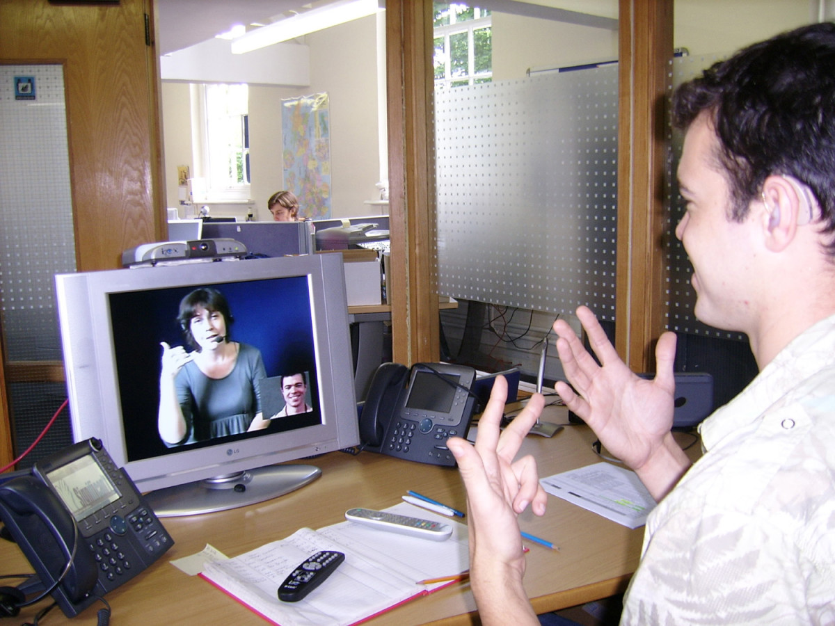 deaf person using a video relay service